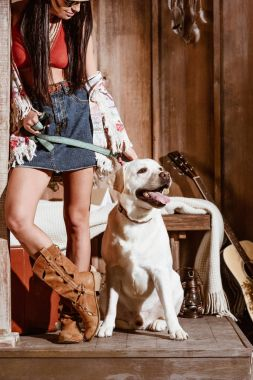 woman in boho style with dog