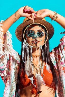bohemian girl holding dreamcatcher
