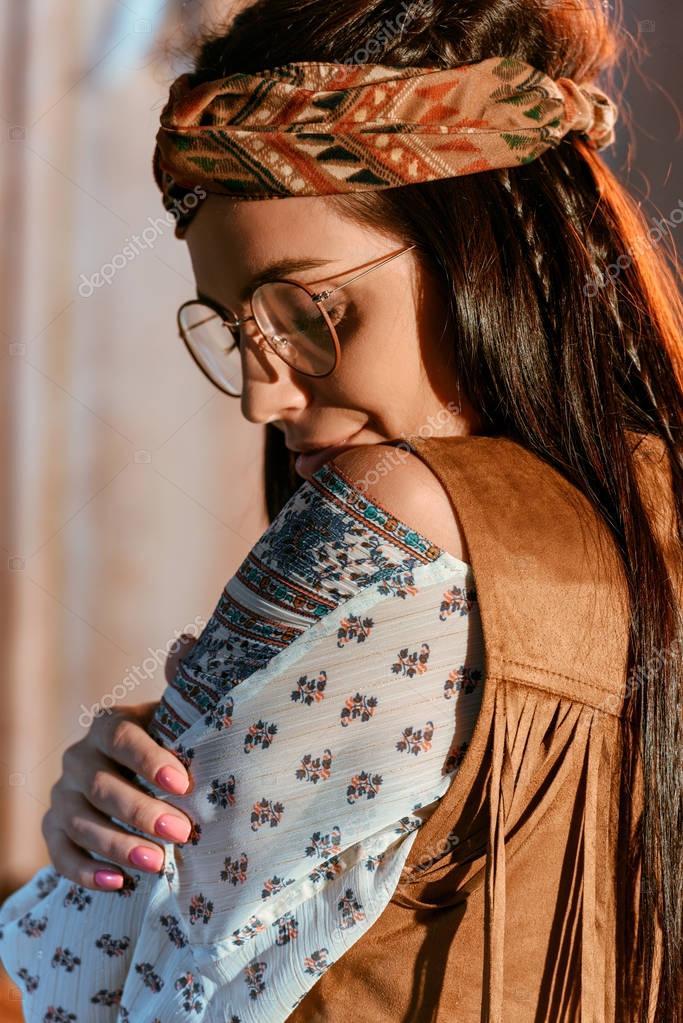 Portrait of stylish bohemian girl in headband and glasses stock vector