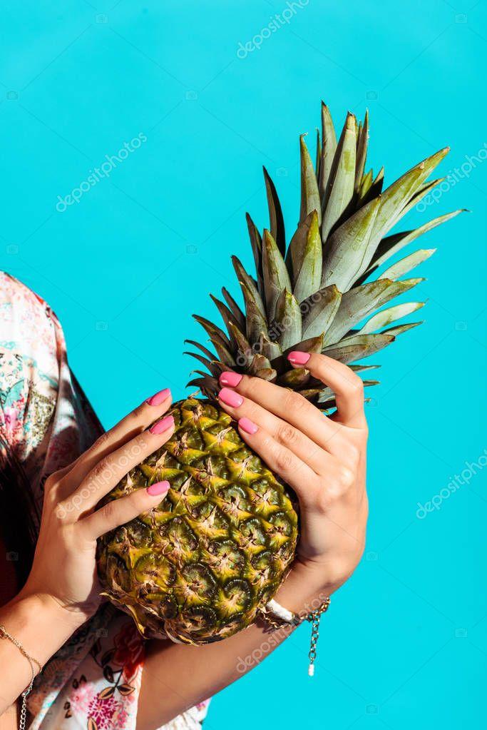 hippie woman holding pineapple