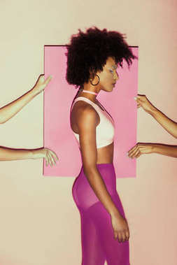 afro model in pink clothes