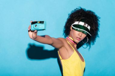 afro girl taking photo on camera