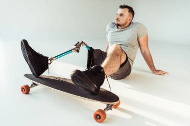 man with leg prosthesis with skateboard