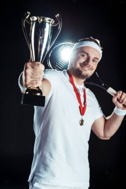tennis player with champion goblet