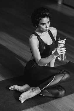 sportive woman with water bottle