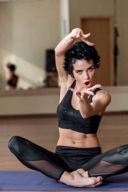 artistic yogini making hands gesture