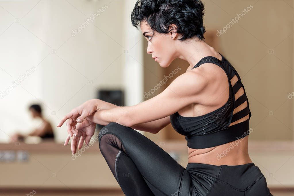 woman sitting in dance studio