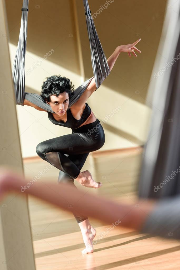 woman practicing acrobatic aerial dance