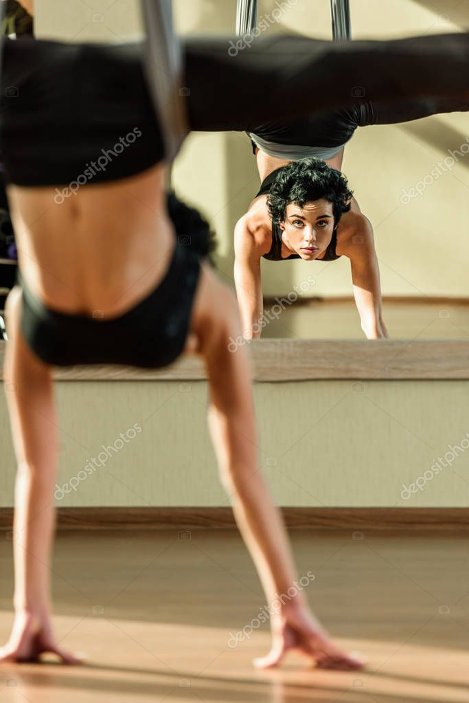 woman practicing fly yoga
