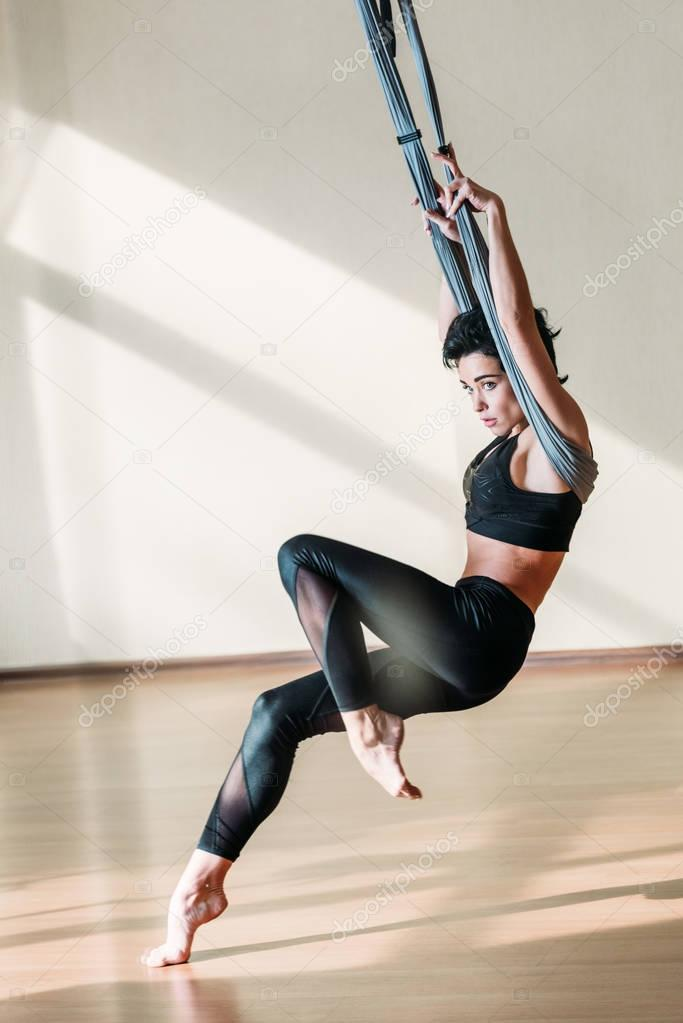 woman practicing acrobatic aerial dance