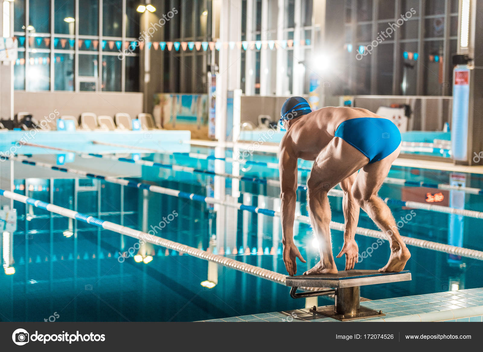 Captivating Swimmer Standing On Diving Board Ready To Jump Into Competition Swimming  Pool U2014 Photo By ArturVerkhovetskiy