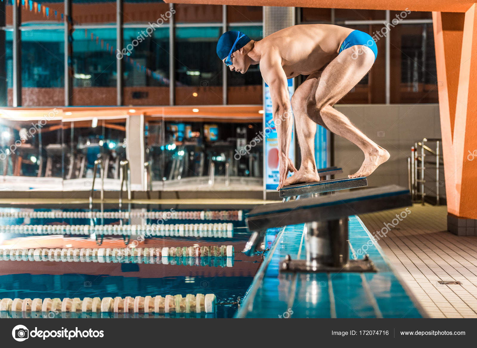 Swimmer Standing On Diving Board Ready To Jump Into Competition Swimming  Pool U2014 Photo By ArturVerkhovetskiy