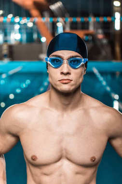 swimmer in swimming cap and goggles