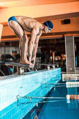 swimmer ready to jump into pool