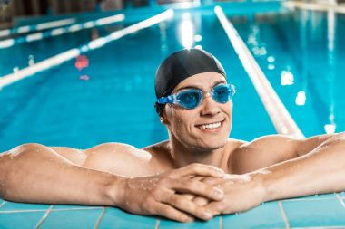 handsome muscular swimmer