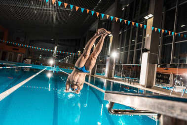 swimmer diving in swimming pool
