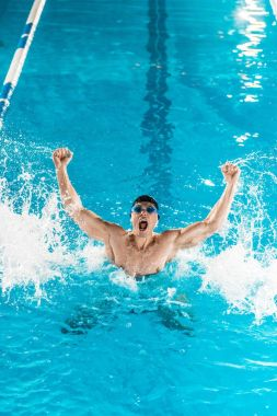 excited swimmer in pool