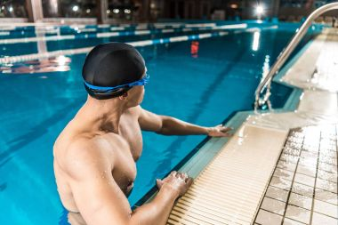 swimmer in swimming cap