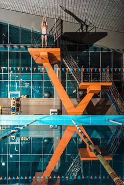 swimmer on diving platform ready to jump