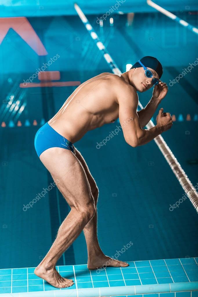 swimmer posing at swimming pool