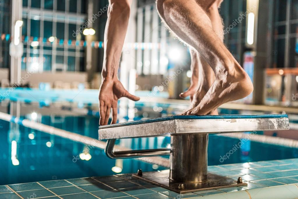 swimmer on diving board ready to jump