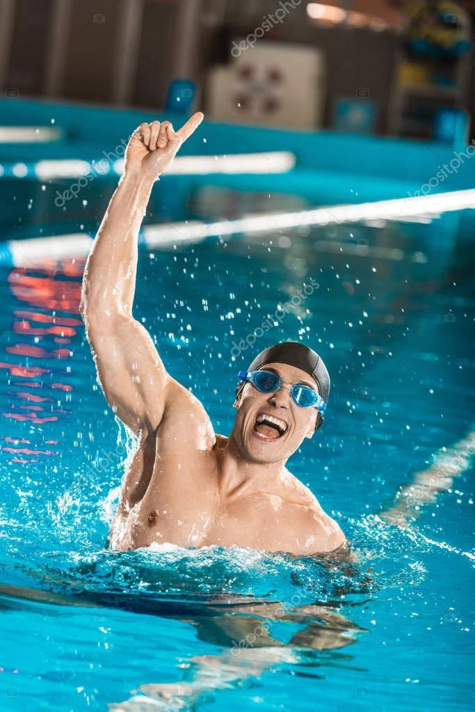 handsome winning swimmer