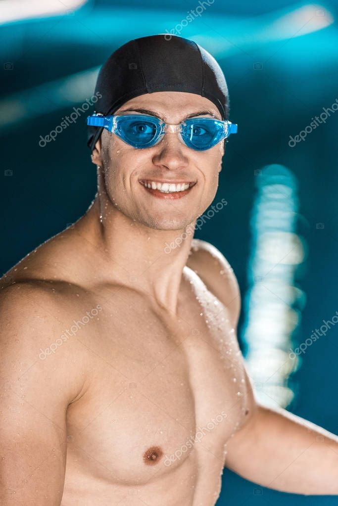 sportsman in swimming cap and goggles