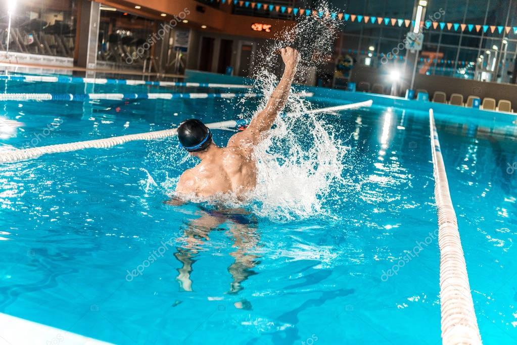 winning swimmer in pool