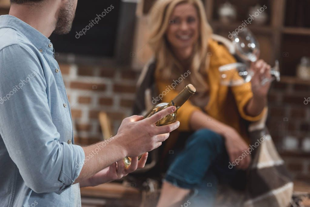 couple with bottle of wine and glasses
