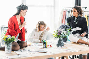 fashion designers working with sketches