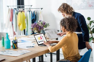 fashion designers working with laptop