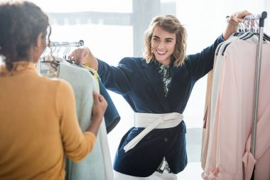 fashion designers working with clothes