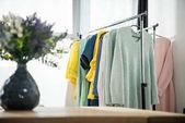 Fotografie fashionable clothes on hangers