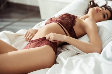 sexy woman in burgundy lingerie