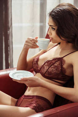 seductive woman drinking coffee