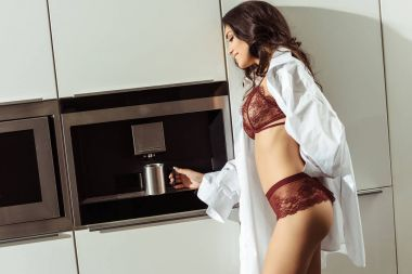 woman making coffee in kitchen