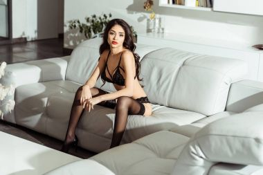 seductive girl posing on sofa