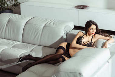 girl in lingerie and stockings on sofa