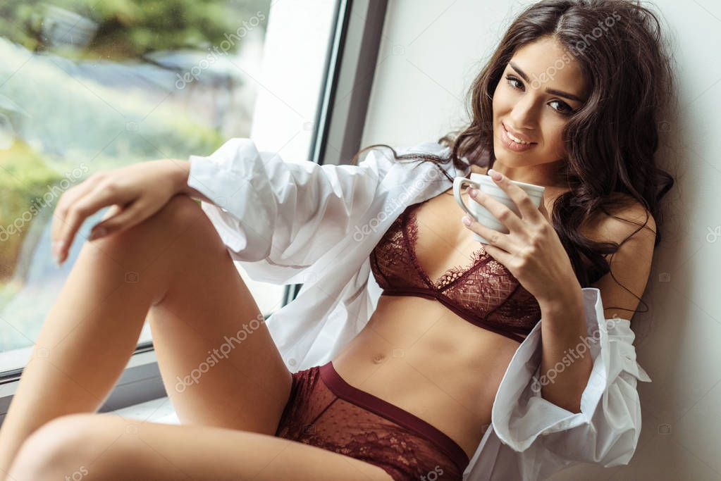 girl in lingerie and shirt with coffee