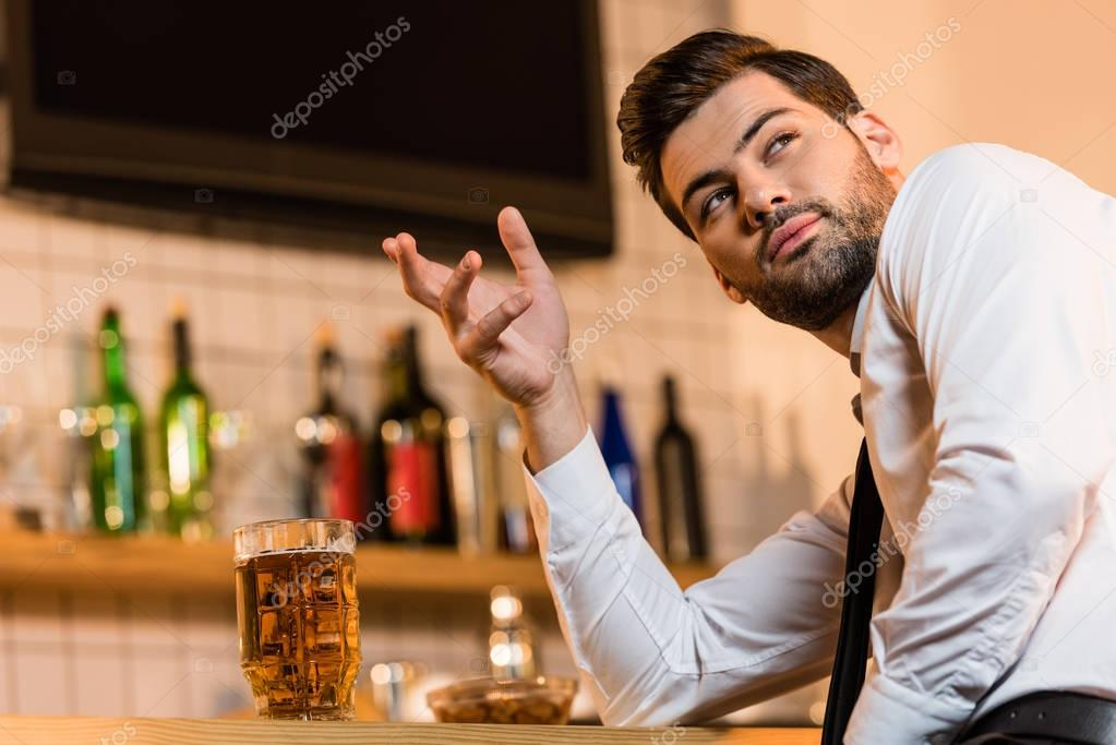 businessman with beer in bar