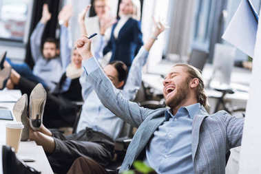 excited businessman at workplace