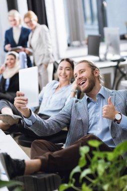 multiethnic businesspeople taking selfie