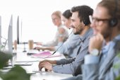 Fotografie call center operator in headset in office