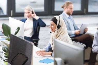 call center operator in headset at workplace