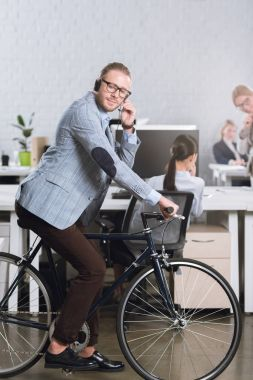 call center operator in headset on bicycle