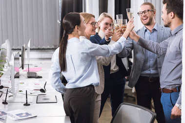 businesspeople clinking glasses of champagne