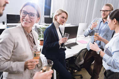 business team drinking champagne