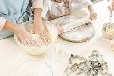 female hands making dough