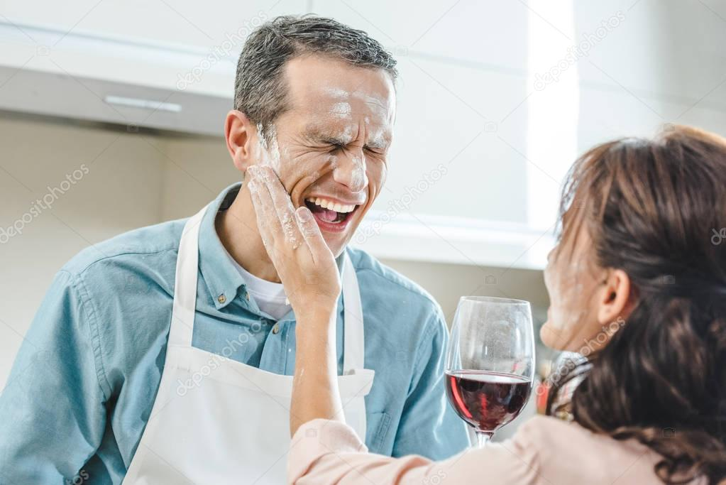 couple in flour with wine