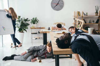 multiethnic group of exhausted businesspeople sleeping at office